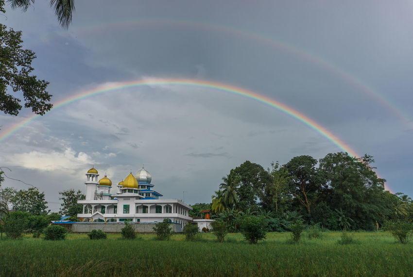Architecture Beauty In Nature Building Exterior Built Structure Cloud - Sky Day Double Rainbow Full Length Grass Masjid Mosque Multi Colored Nature No People Outdoors Paddy Field Rainbow Scenics Sky Tree Islam Ied Ramadhan Mawlid