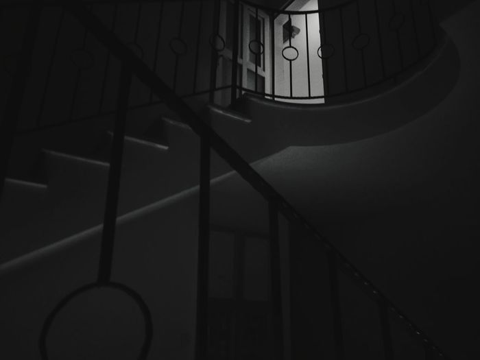 EyeEm Selects Walking Around Smartphonephotography Nightphotography darkness and light Dim Light Blackandwhite Photography Building Story Blackandwhite Shadow Architecture Built Structure Building Exterior Spiral Staircase Steps And Staircases Spiral Stairs Spiral