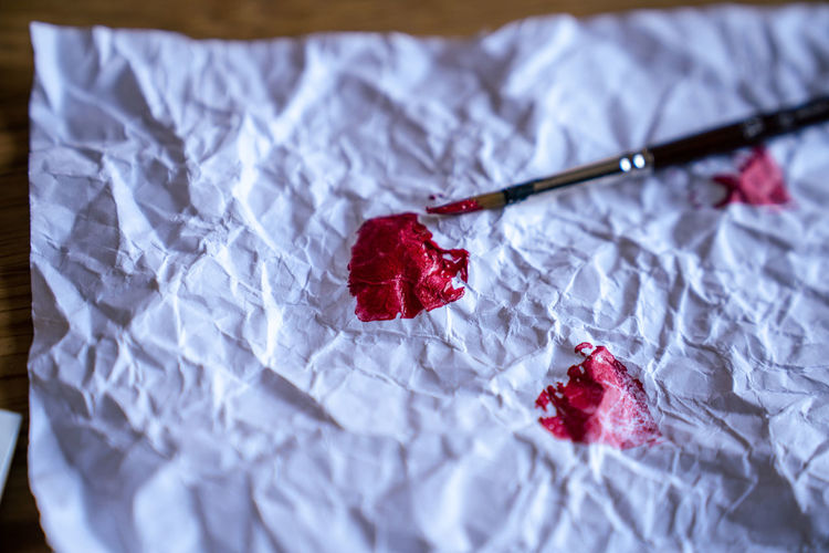 Close-up of red heart shape on paper