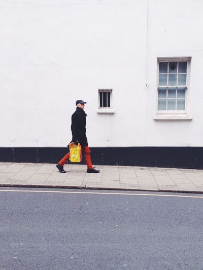Red trousers. Minimalism Strideby London Pedestrian