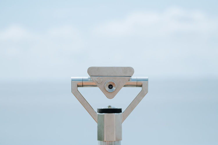 Coin operated binocular viewer next to the waterside promenade
