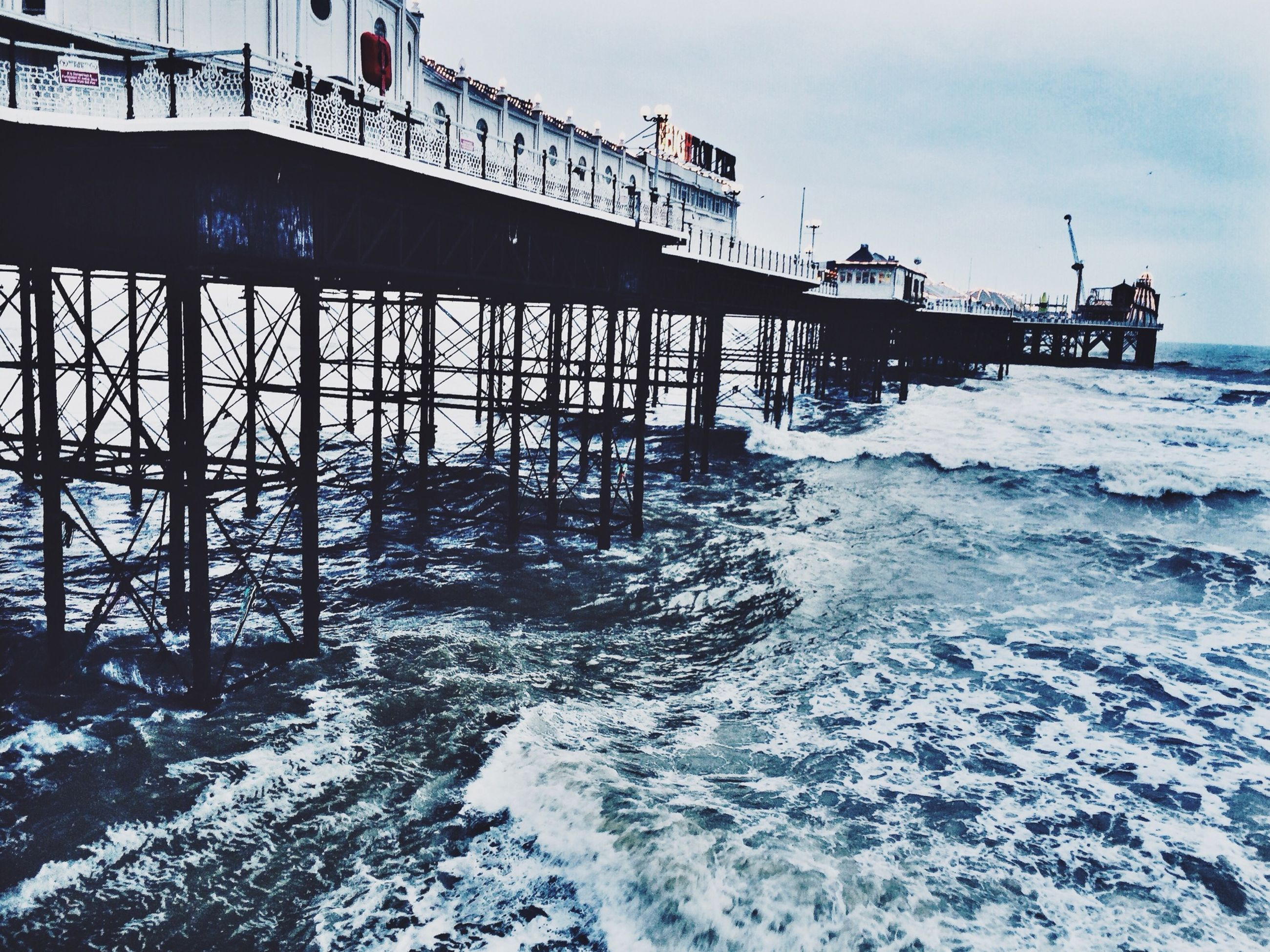 water, sea, built structure, architecture, sky, pier, waterfront, bridge - man made structure, wave, connection, nature, outdoors, transportation, rippled, surf, horizon over water, scenics, beauty in nature, river, no people