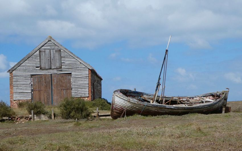 Thornham building and old sail boat Eyem Best Shots Nature_collection Eyemphotography EyEmNewHere EyeEm Nature Lover Copy Space Sky Transportation Nautical Vessel Cloud - Sky Abandoned Mode Of Transportation Nature Damaged Built Structure Run-down Deterioration Old
