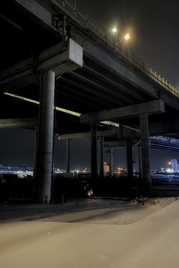 Low angle view of elevated road at night