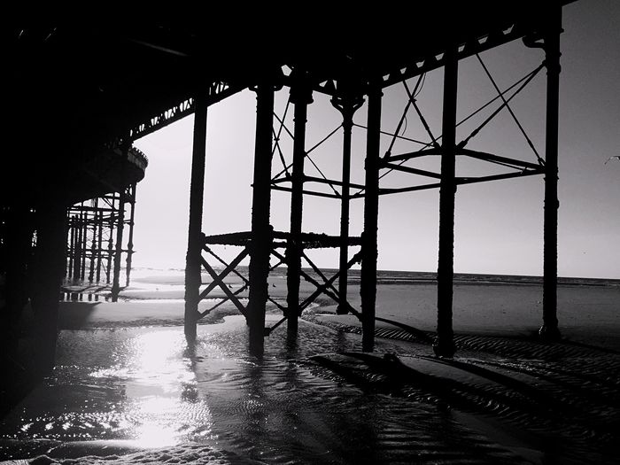 Pier Sea Beachphotography Blackandwhite Photography From Where I Stand From My Point Of View Sun Reflection Under A Pier Creative Light And Shadow