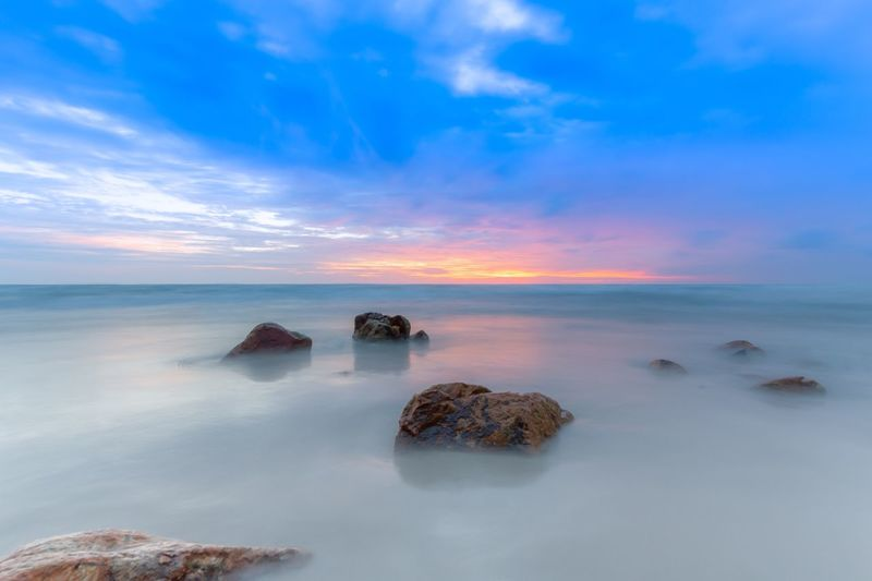 Sea Sky Beauty In Nature Scenics Horizon Over Water Rock - Object Cloud - Sky Blue No People Sunset Water Nature Tranquil Scene Tranquility Idyllic Outdoors Beach Wave Day