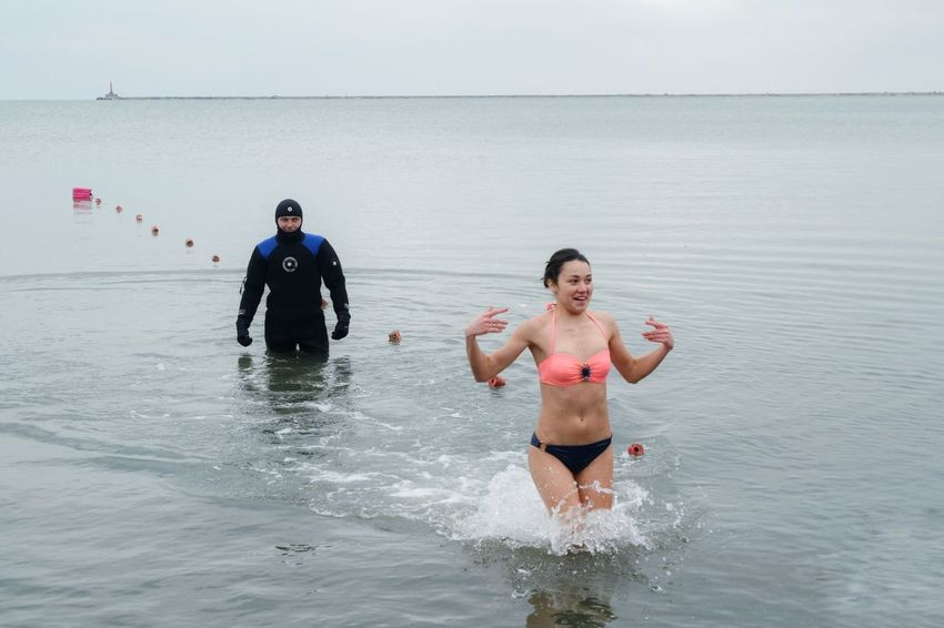 Water Epiphany Splashing Sport Sea Fun Leisure Activity Two People Outdoors Vacations Swimming Togetherness Enjoyment Aquatic Sport Adventure Friendship Motion Fun Man Day Cold Day Azov Sea Ukraine Ukraine 💙💛 Cold Temperature