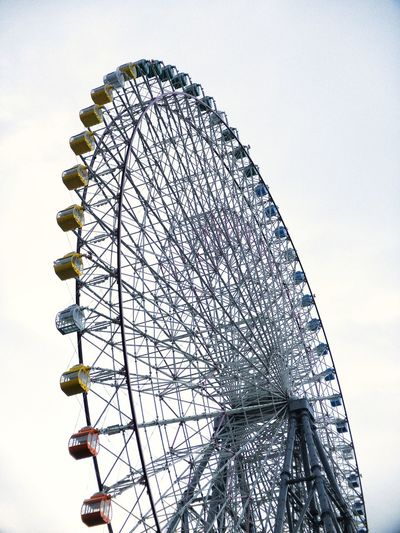 Tempozan Ferries Wheel at Osaka,Japan Tempozan Ferris Wheel Japan OSAKA Amusement Park Ride Amusement Park Low Angle View Ferris Wheel Sky Nature Arts Culture And Entertainment Leisure Activity Outdoors Clear Sky
