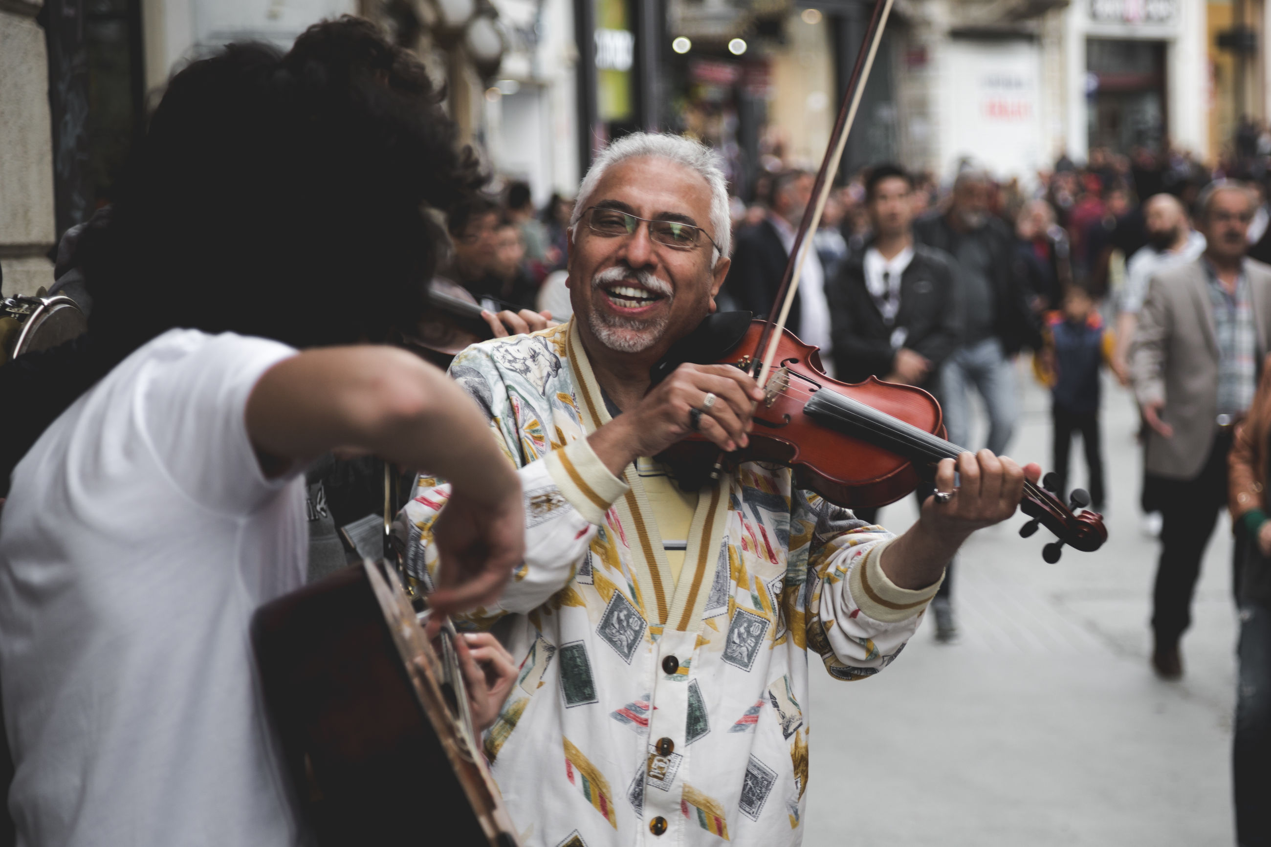 music, real people, musician, musical instrument, arts culture and entertainment, playing, togetherness, men, senior adult, performance, leisure activity, two people, holding, violin, standing, lifestyles, outdoors, day, adult, people