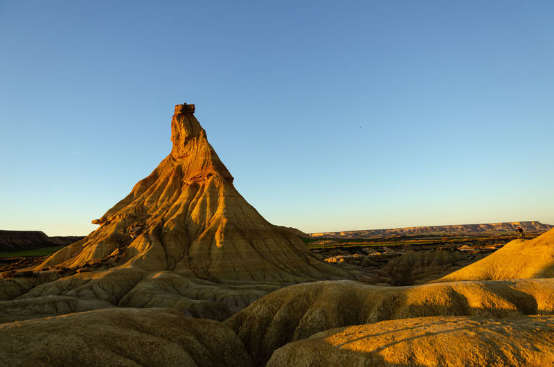 Scenic view of land against clear sky during sunset, bardenas reales, spain