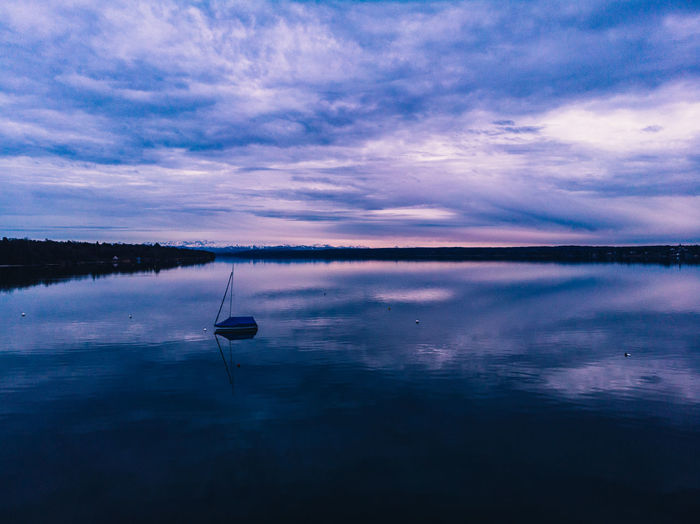 Water Sky Reflection Cloud - Sky Beauty In Nature Scenics - Nature Tranquility Tranquil Scene Lake Waterfront Nature No People Non-urban Scene Idyllic Dusk Nautical Vessel Sunset Silhouette Standing Water Outdoors Sailboat Drone  Dronephotography Drone Photography Aerial View Aerial Shot