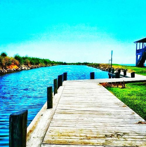 Sitting on the dock Water Pier Outdoors No People Day Wood - Material Blue Clear Sky Lake Nature Beauty In Nature Sky Jetty Low Angle View Multi Colored EyeEm Selects EyeEmNewHere Sommergefühle Amatuer Photographer EyeEm Vision Eyemphotography Backgrounds Beautiful World Let's Go. Together. Louisiana