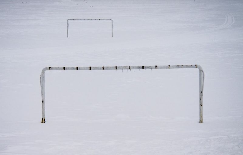 Soccer goal on snow covered field