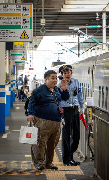 Two People Men Transportation Real People Adult Standing City Males  Incidental People People Mature Adult Lifestyles Public Transportation Clothing Architecture Smiling Portrait Day Front View Mature Men