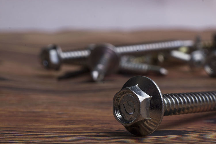Close-up of nut and bolts on table