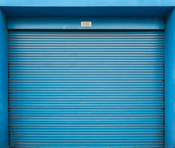 Closed Blue Shutter Of Store