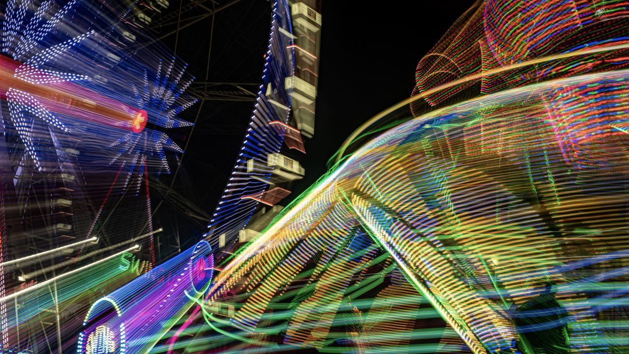 LOW ANGLE VIEW OF LIGHT TRAILS