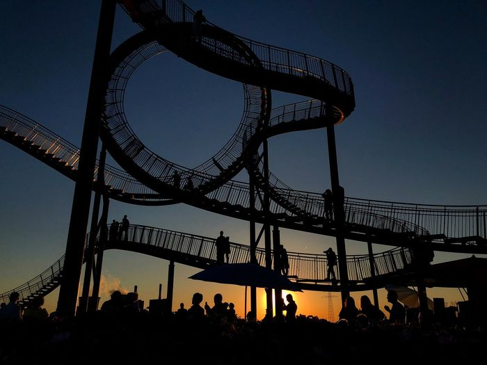 Sunset in Duisburg Sky Architecture Built Structure Silhouette Arts Culture And Entertainment Amusement Park Ride Rollercoaster Nature Sunset Crowd Group Of People Outdoors Metal Amusement Park #urbanana: The Urban Playground