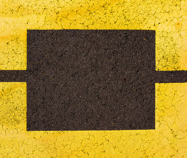 Backgrounds Black Color Close-up Concrete Day Directly Above Dividing Line Full Frame Geometric Shape High Angle View Marking No People Outdoors Pattern Road Road Marking Shape Sign Symbol Textured  Transportation Yellow
