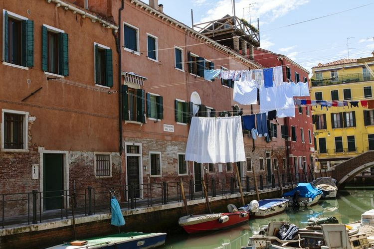 Laundry hanging over grand canal by buildings