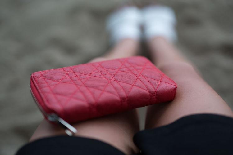 Wallet on woman's lap