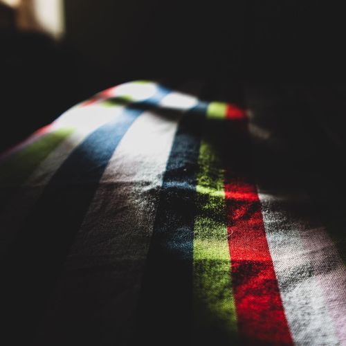 High angle view of multi colored shadow on bed at home