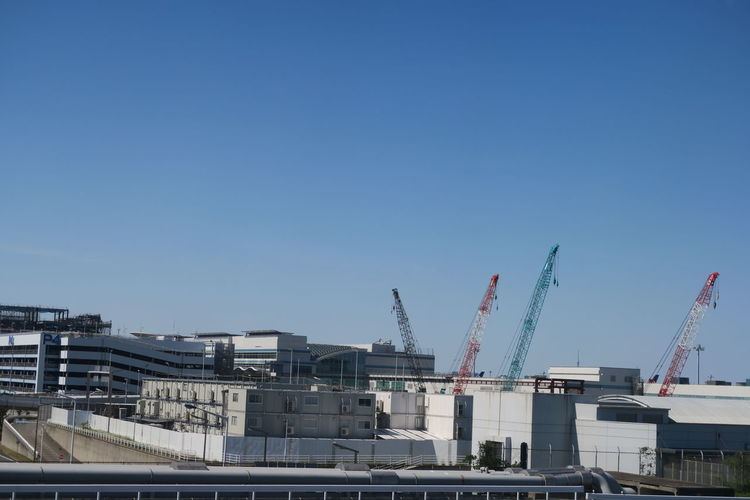 View of construction site against clear blue sky