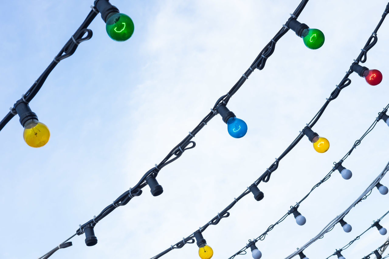 Low Angle View Of Colorful Light Bulbs Against Sky