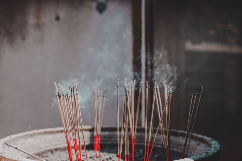 Close-up of smoke emitting from incense