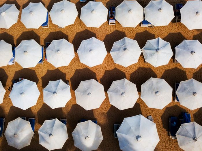 Full frame shot of parasols at beach during sunny day
