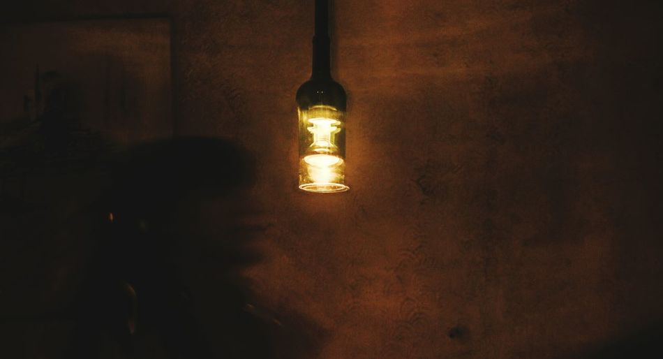 Illuminated lamp post at night