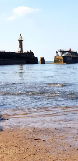 Walking Around Yorkshire Whitby Sea And Sky Whitby North Yorkshire Whitby Harbour Whitby View Sea View Blue Sky Blue Sea Water Sea Beach Sky Architecture Building Exterior Lighthouse Low Tide Coast Seascape Coastal Feature