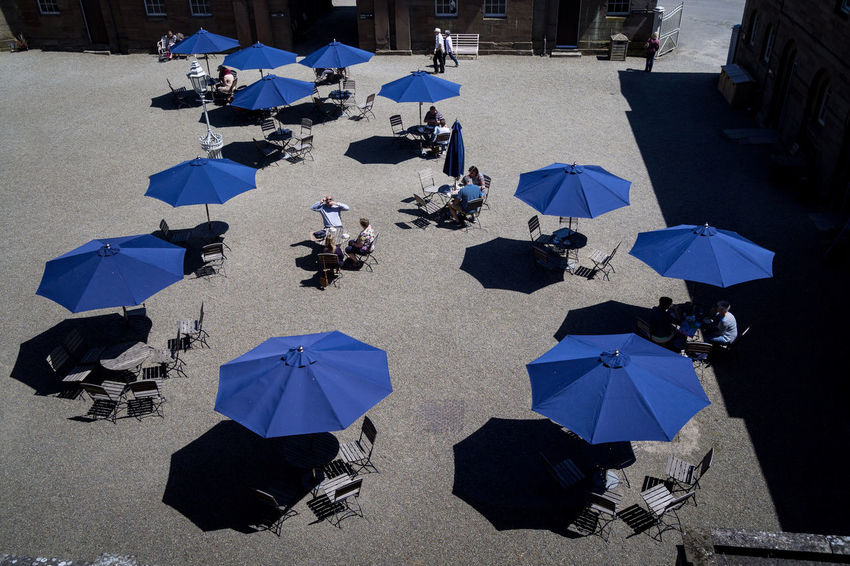 Shade - Blue Chair City Crowd Day Group Of People High Angle View Large Group Of People Nature Outdoors Parasol Protection Rain Real People Security Shadow Street Sunlight Table Umbrella