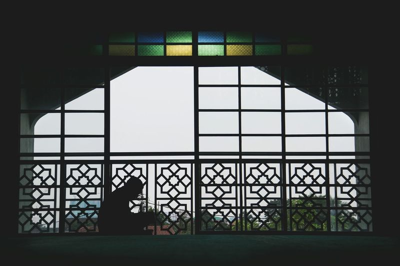 View of built structure through window