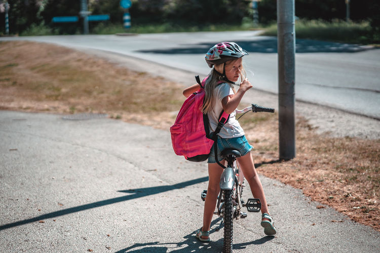 Bicycle Child Childhood Cycling Day Focus On Foreground Full Length Headwear Helmet Leisure Activity Lifestyles Males  One Person Outdoors Real People Ride Riding Road Sport Sunlight Transportation