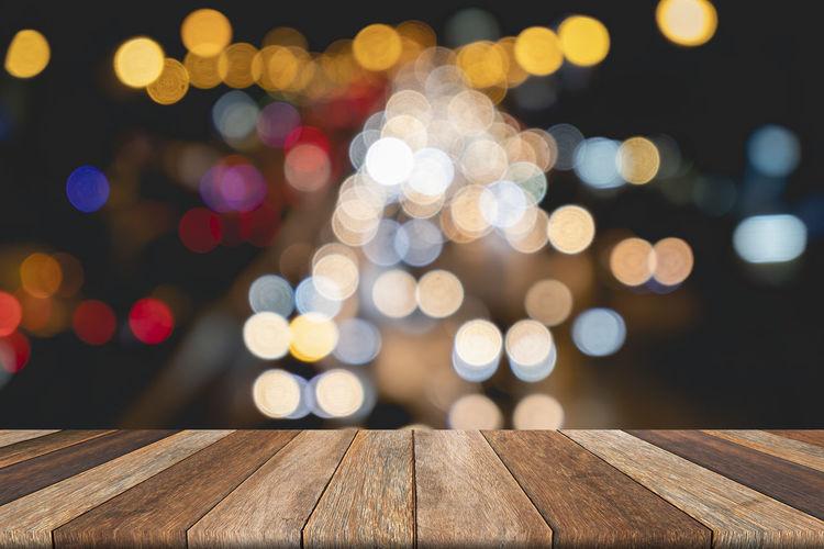 Defocused image of illuminated lights on table