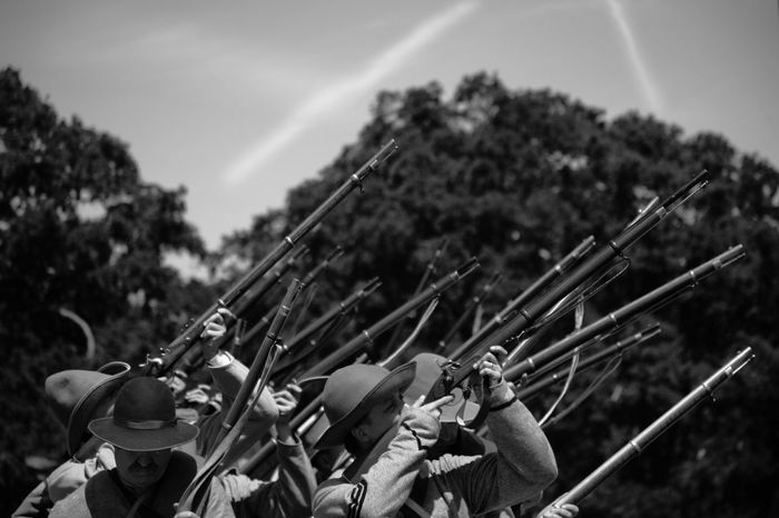 Volunteers of the 1st Reg't Texas Infantry fires off rounds in memory of those who died at the civil war after the battle re-enactment at Fort Tejon in Lebec, California. The Texans fought in 38 engagements including six of the greatest battles of the war. Civil War Civil War Re-enactments Horizontal USA Black And White Day Hobbies Men Outdoors People Real People Shooting Tree Weapon