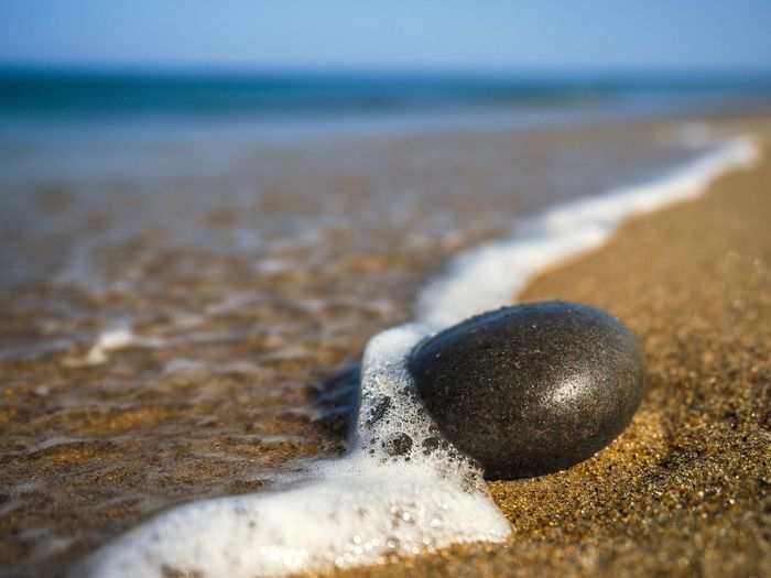 Pebble at the beach in Denmark Denmark Pebbles And Stones Pebble Beach Pebble Beach Land Sand Sea Water Nature Sport No People Day Close-up Focus On Foreground Wave Beauty In Nature Selective Focus Horizon Over Water Outdoors Horizon