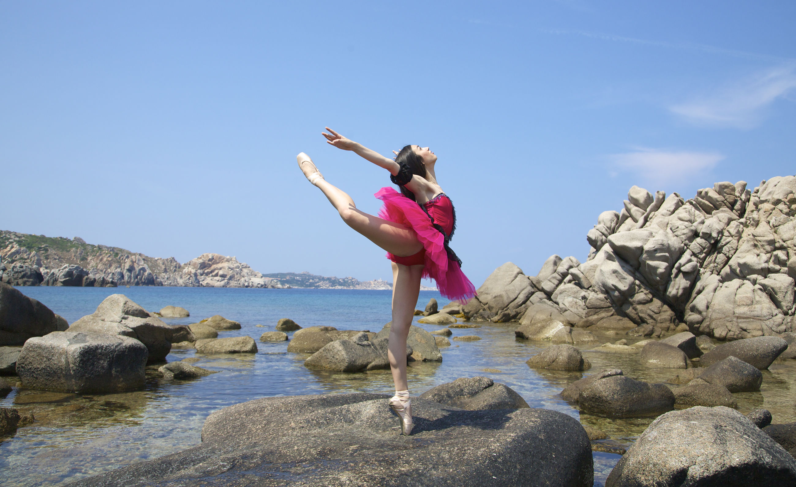 full length, lifestyles, leisure activity, water, casual clothing, person, arms outstretched, jumping, young adult, enjoyment, arms raised, standing, fun, vacations, sea, young women, mid-air, front view