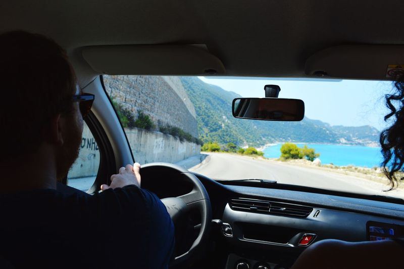 On The Way To  Milos Beach in Lefkada Driving Backseat Car Roadtrip Road Sea Friends Live For The Story Connected By Travel Connected By Travel