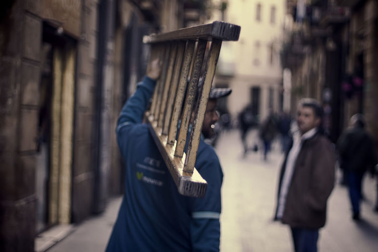 Bokeh Focus On Foreground Ladder Lifestyles Man And Ladder Selective Focus Streetphotography Streets Of Barcelona Textured  Wood Close Up Street Photography