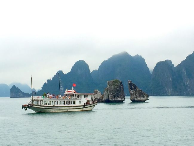 EyeEm Selects Mountain Transportation Nautical Vessel Nature Scenics Mode Of Transport Water Beauty In Nature Mountain Range Tranquility Tranquil Scene Day Waterfront Sea Outdoors Travel Destinations Sky Vacations No People Ha Long Bay Cruise Ha Long UNESCO World Heritage Site Travel Travelgram