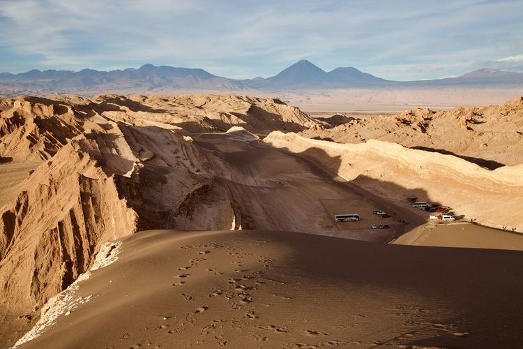 Scenic view of desert road against sky