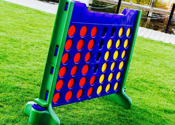 Blue Collection Connect 4 Day Focus On Foreground Game Grass Grassy Green Color Large Group Of Objects Leisure Activity Man Made Object Multi Colored No People Outdoor Games Outdoors Red