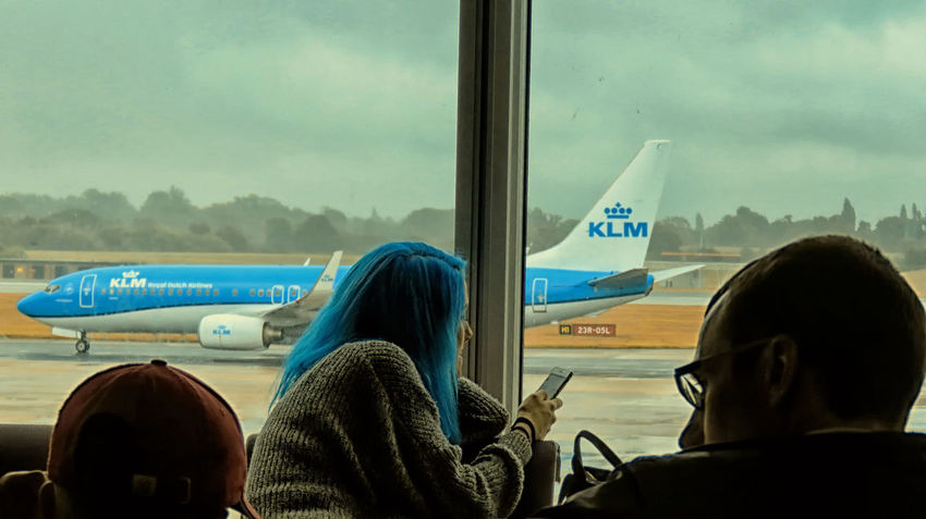 Out of the blue. KLM Airport Manchester Manchester Airport Plane People Watching People Waiting Silhouette EyeEm Gallery Creative Photography Creativity Creativephotography Eyeem Market Coulourful CreativePhotographer Sky And Clouds Great Britain United Kingdom England Europe Flying Dutch Travelgram Travelling Hair Colour