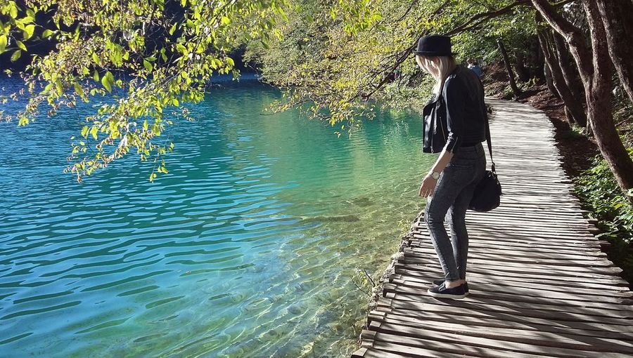 Happytimes Vacations MomentsToRemember Bestmoment Peaceful Place Peaceful Moment Nature Photography Nature Lake Plitvice Lakes National Park Plitvice National Park Water Full Length Women Lake Standing Sunlight Low Section Walking Reflection Calm Lakeside First Eyeem Photo