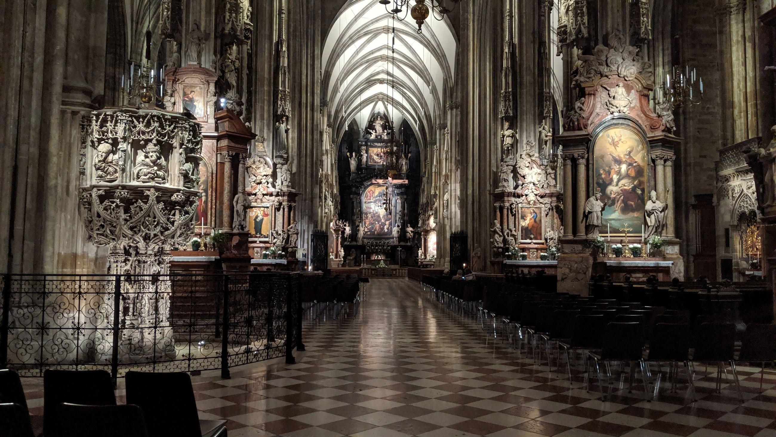 place of worship, religion, belief, architecture, building, built structure, indoors, spirituality, the past, history, architectural column, altar, glass, sculpture, pew, flooring, tiled floor, gothic style, aisle