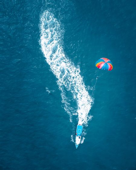 Super ride Parachute Aerial Aerial View Boat Mavic 2 Pro Dji Water Sea Sport Aquatic Sport Adventure Real People 17.62° Leisure Activity Nature Day People Unrecognizable Person Blue Holiday Lifestyles High Angle View UnderSea Motion Nautical Vessel Outdoors