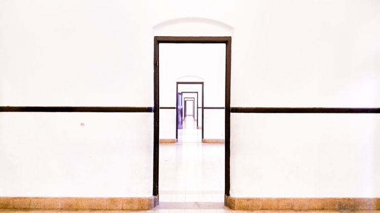 The Lawang Sewu named because it means Thousand Doors Lawang Sewu Historic Historical Building Semarang EyeEm Selects Symmetry Modern Politics And Government Architecture Open Door Door Door Knocker Office Building Entrance
