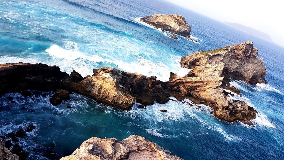Sea Aerial View High Angle View Water Rock Blue No People Outdoors Nature Wave Beauty In Nature Gwadeloupe Guadeloupe Tropiques Gwada  Tropical Climate
